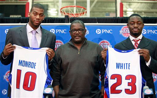 Description of . Joe Dumars, center, Detroit Pistons president of basketball operations, stands with draft picks Greg Monroe, left, and Terrico White during a news conference, Saturday, June 26, 2010, in Auburn Hills, Mich. Monroe, a 6-foot-11 forward from Georgetown, was the No. 7 pick and White, a 6-foot-5 guard from Mississippi, was the No. 36 pick. (AP Photo/Al Goldis)