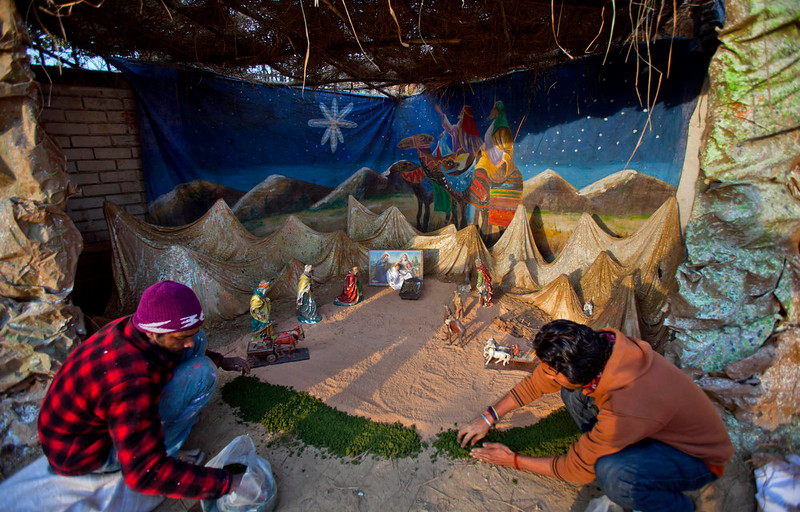 . Pakistani Christians give final touches to the Nativity scene set up in an enclosure in preparation for Christmas in Islamabad\'s slums, Pakistan, Wednesday, Dec. 24, 2014. (AP Photo/Anjum Naveed)