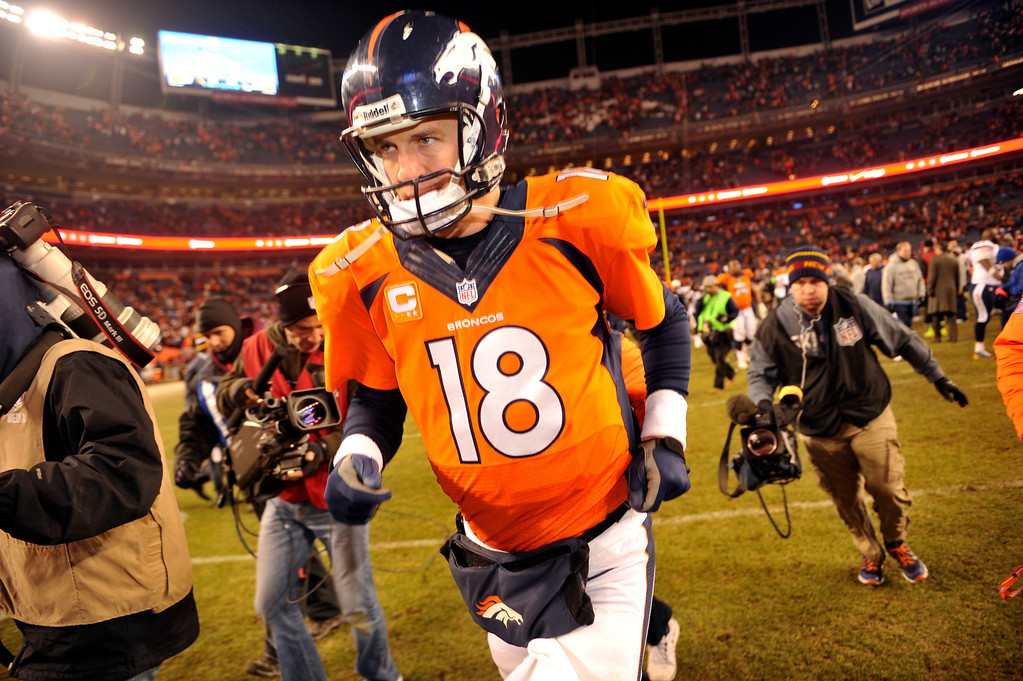 . Denver Broncos quarterback Peyton Manning (18) runs off the field after losing to the San Diego Chargers 27 to 20.  The Denver Broncos vs. the San Diego Chargers at Sports Authority Field at Mile High in Denver on December 12, 2013. (Photo by Hyoung Chang/The Denver Post)