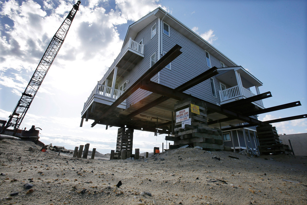 . An oceanfront home is being raised to protect from flooding in Ortley Beach, N.J., Thursday, April 25, 2013. Six months after Suprestorm Sandy devastated the Jersey shore and New York City and pounded coastal areas of New England, the region is dealing with a slow and frustrating, yet often hopeful, recovery. (AP Photo/Mel Evans)