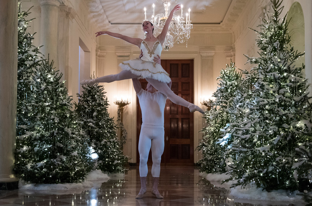 . A ballerina is lifted during a performance of a piece from The Nutcracker among the 2017 holiday decorations in the Cross Hall of the White House in Washington, Monday, Nov. 27, 2017. (AP Photo/Carolyn Kaster)