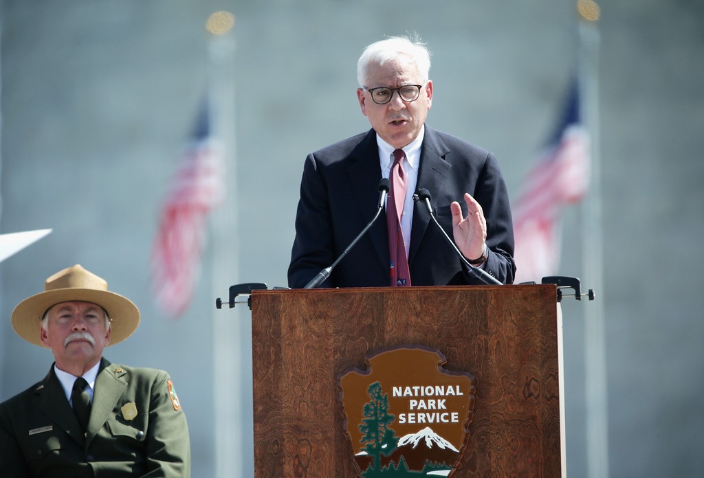 . Co-Founder and Co-CEO of The Carlyle Group David Rubenstein (R) speaks as National Park Service Director Jonathan Jarvis (L) listens during a reopening ceremony for the Washington Monument May 12, 2014 in Washington, DC. (Photo by Alex Wong/Getty Images)