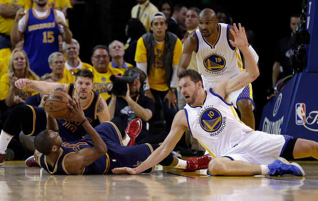 . Golden State Warriors forward David Lee (10) defends as Cleveland Cavaliers forward James Jones, bottom left, looks to pass the ball during the first half of Game 5 of basketball\'s NBA Finals in Oakland, Calif., Sunday, June 14, 2015. (AP Photo/Ben Margot)