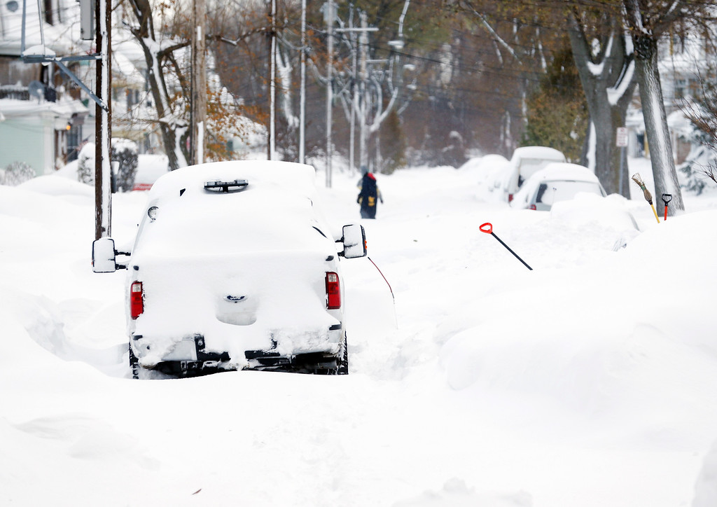 . A snow-bound truck blocks a street in the south Buffalo area on Thursday, Nov. 20, 2014, in Buffalo, N.Y. A new blast of lake-effect snow pounded Buffalo for a third day piling more misery on a city already buried by an epic, deadly snowfall that could leave some areas with nearly 8 feet of snow on the ground when it\'s all done. (AP Photo/Mike Groll)