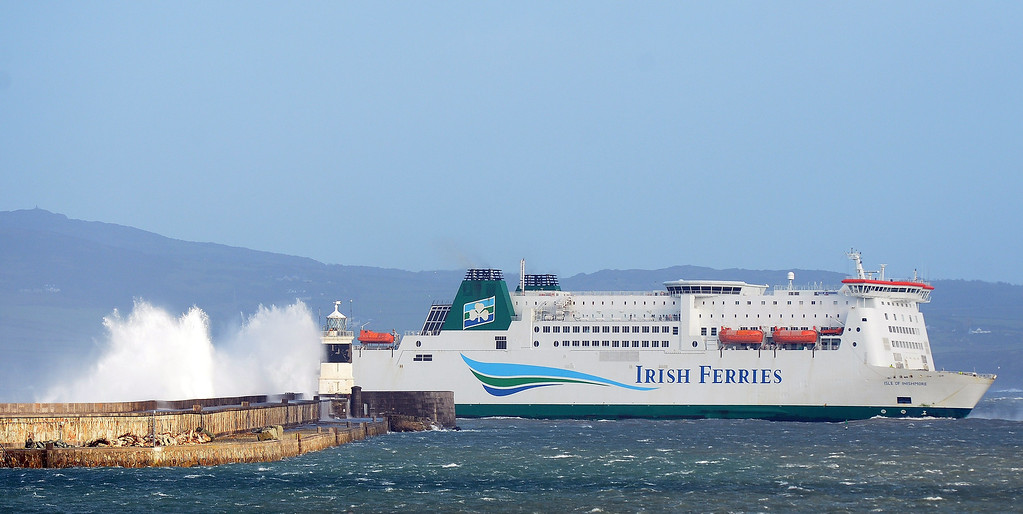 . Strong winds cause the waves to hit the breakwater at Holyhead as the Irish Ferries ship Isle of Inishmore pulls into the harbour on the Island of Anglesey in Wales on January 7, 2014.   PAUL ELLIS/AFP/Getty Images