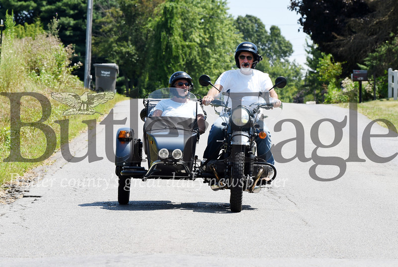 Harold Aughton/Butler Eagle: At first glance, Jon and Rose Moore's side-by-side resembles somthing from a Hogan Hero's sitcom or any WW II movie. However, at a closer look, the antique looking motorcyle is actually a 2017 Russian Ural.