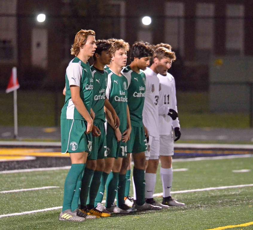 . Paul DiCicco - The News-Herald Lake Catholic and University players line up during a free kick Oct. 28.