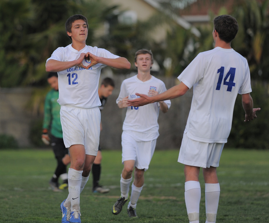 . 02-15-2012--(LANG Staff Photo by Sean Hiller)- Los Alamitos beat Buena 4-1 in the first round of the Division 1 boys soccer playoffs Friday at Laurel School in Los Alamitos. Daniel Weis celebrates his goal on a penalty kick.