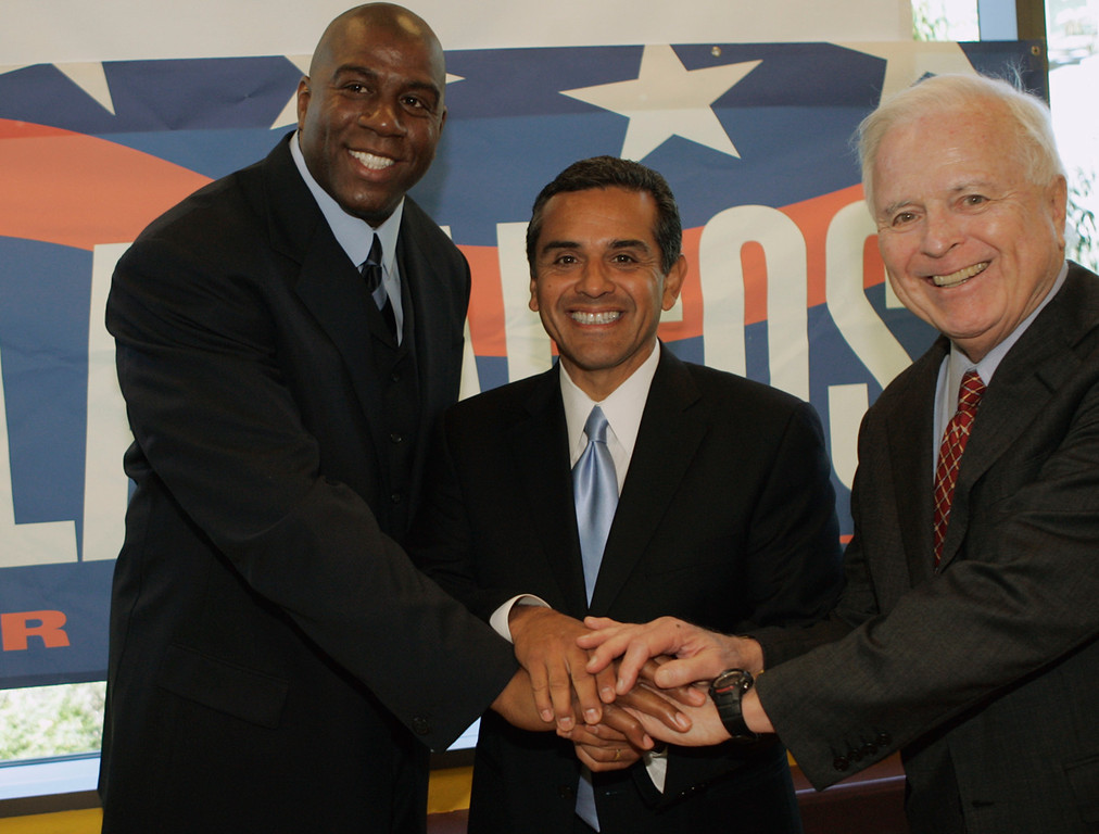 . Los Angeles mayoral candidate Antonio Villaraigosa, middle, receives the endorsement of the former Los Angeles Lakers star and CEO of Magic Johnson Enterprises, left, Earvin �Magic� Johnson, and former Los Angeles mayor, and former California Secretary of Education Richard J. Riordan, Monday April 11, 2005, at news conference at the 24 Hour Fitness Sports Club in Sherman Oaks, Calif. (AP Photo/Damian Dovarganes)
