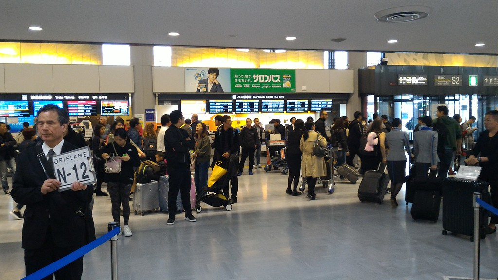 Entering the arrivals hall from customs