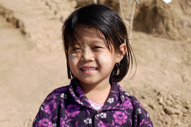 Sweet smiles from a child in Mandalay, Burma.