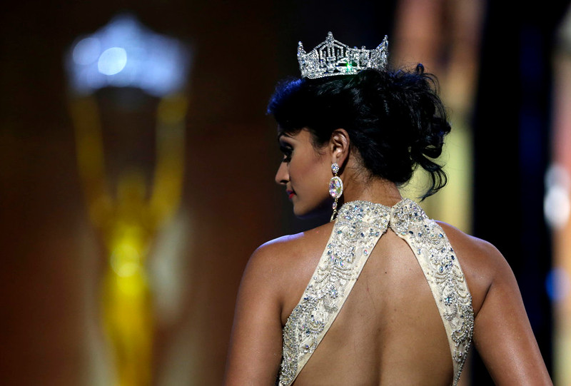 . Miss America 2014 Nina Davuluri walks on stage during the Miss America 2015 pageant, Sunday, Sept. 14, 2014, in Atlantic City, N.J. (AP Photo/Julio Cortez)