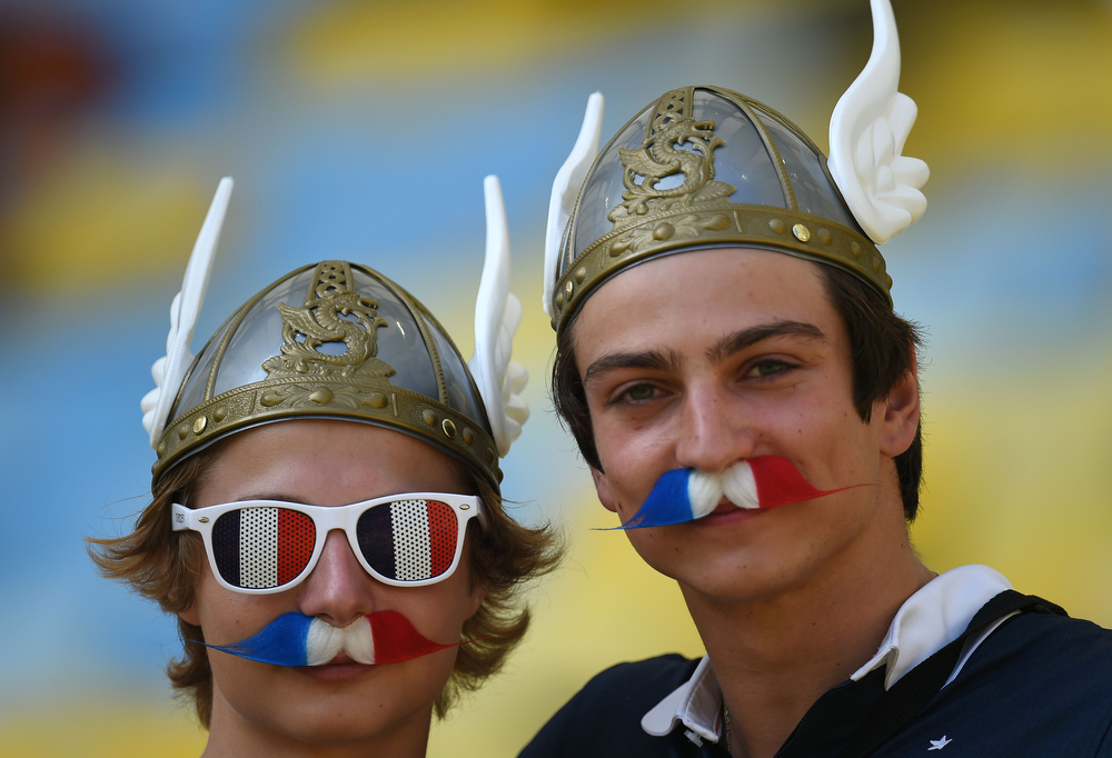. French supporters cheer before a quarter-final football match between France and Germany at the Maracana Stadium in Rio de Janeiro during the 2014 FIFA World Cup on July 4, 2014.  (YASUYOSHI CHIBA/AFP/Getty Images)
