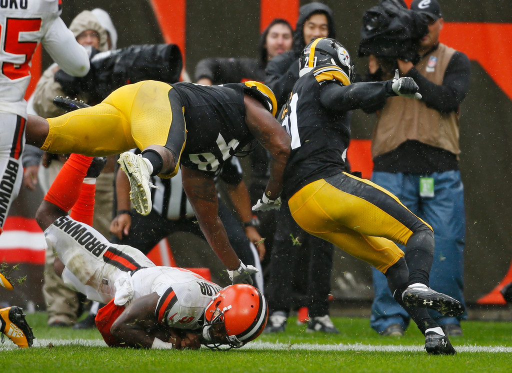 . Cleveland Browns quarterback Tyrod Taylor, bottom, rushes for a 20-yard touchdown during the second half of an NFL football game against the Pittsburgh Steelers, Sunday, Sept. 9, 2018, in Cleveland. (AP Photo/Ron Schwane)