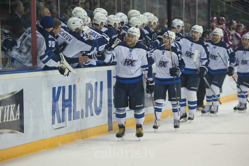 Players of Neftekhimik Nizhnekamsk celebrate the goal with Andrei Sergeyev (26) in the front