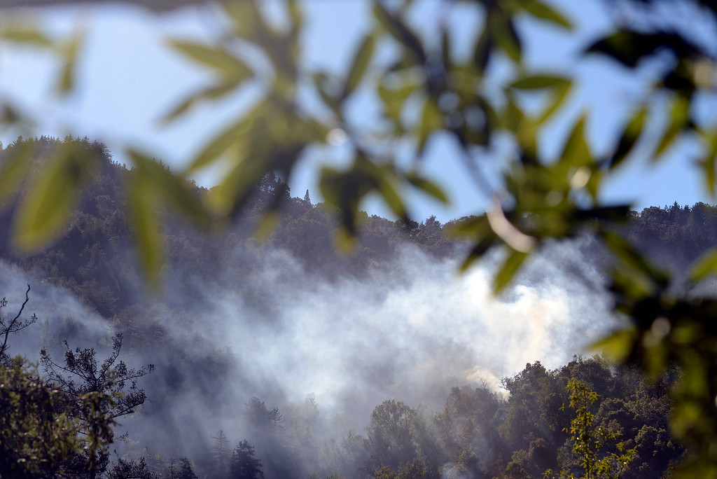 . Smoke drifts from remaining hotspots on Pfeiffer Ridge above Fernwood as firefighters near the end of their battle with the Pfeiffer Ridge Fire in Big Sur, Calif. on Friday December 20, 2013. (Photo David Royal/ Monterey County Herald)