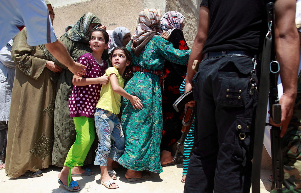 . Girls queue to buy bread at the only bakery serving the outskirts of Idlib province August 1, 2012. REUTERS/Zohra Bensemra