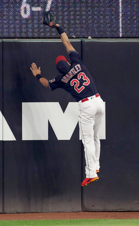 . Cleveland Indians\' Michael Brantley catches a ball hit by Minnesota Twins\' Joe Mauer in the first inning of a baseball game, Tuesday, Aug. 7, 2018, in Cleveland. Mauer was out on the play. (AP Photo/Tony Dejak)