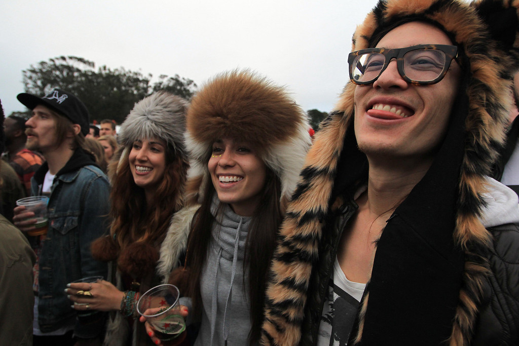 . Ricardo Guerrero, Lauren Harrington and Natalie Pasquale, right to left, of Las Vegas, listen to Paul McCartney at the Land\'s End main stage during the 6th annual Outside Lands Music and Arts Festival in Golden Gate Park in San Francisco, Calif., on Friday, Aug. 9, 2013.  (Jane Tyska/Bay Area News Group)