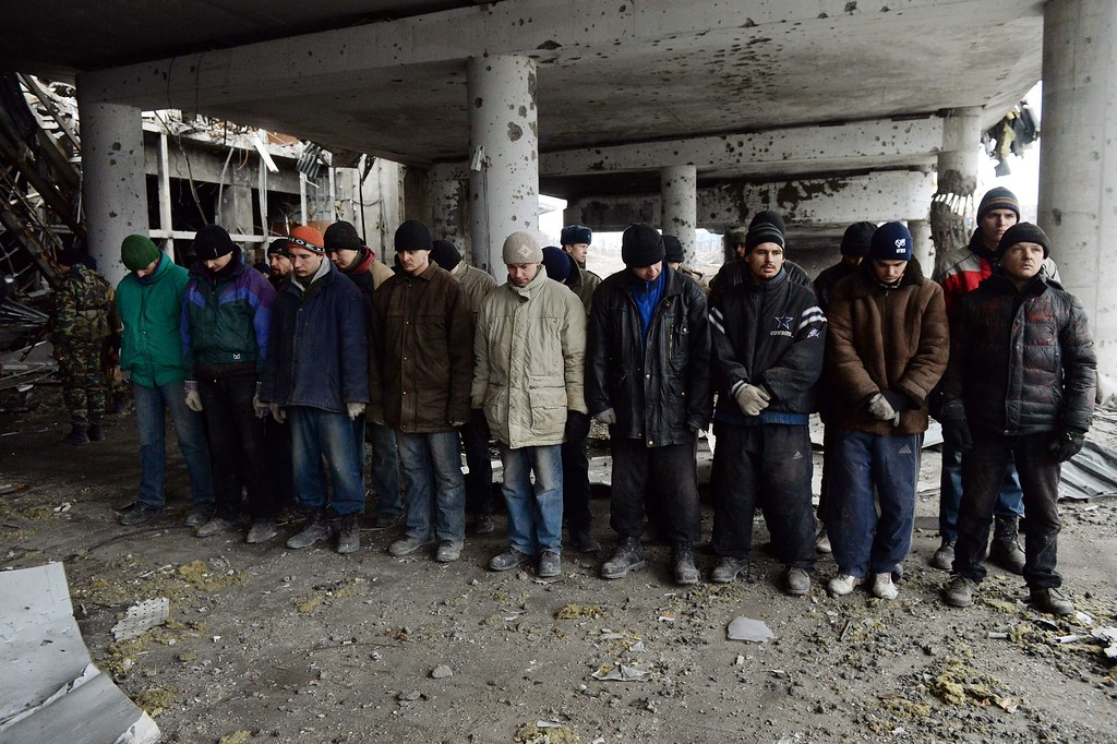 . Ukrainian prisoners of war stand inside a destroyed airport building in the eastern Ukrainian city of Donetsk on February 26, 2015. Ukraine\'s military said Thursday it was starting the withdrawal of heavy weapons from the frontline with pro-Russian rebels, a key step in a stuttering peace plan. The start of the withdrawal by Kiev comes after a shaky truce that was meant to come into force February 15 finally took hold across the Ukraine conflict zone in recent days. VASILY MAXIMOV/AFP/Getty Images