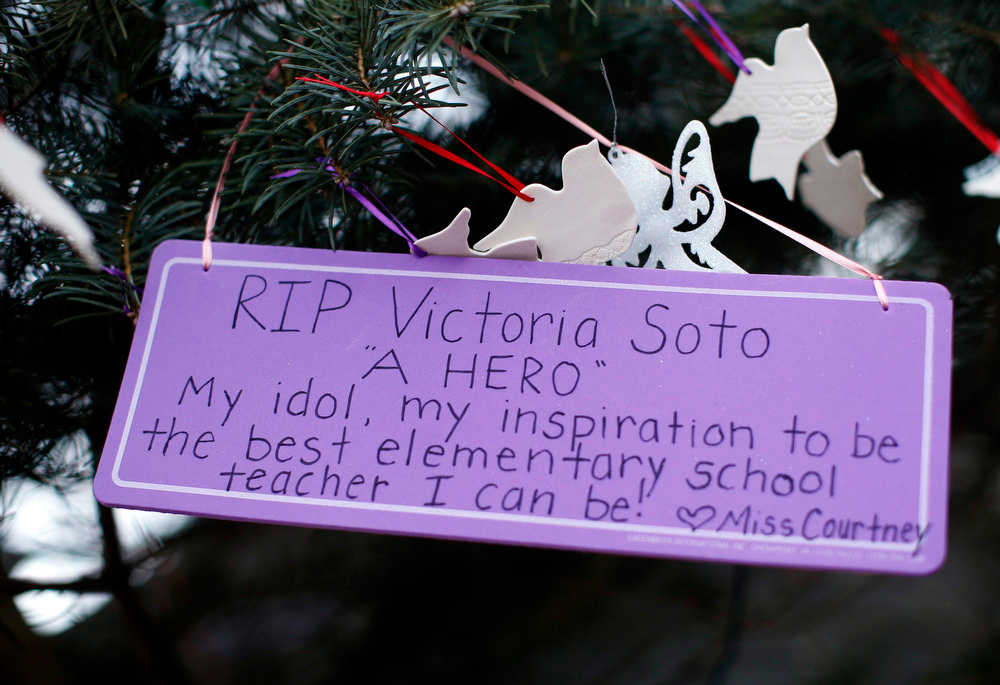 Description of . A sign in remembrance of teacher Victoria Soto, one of those killed in the December 14 shootings at Sandy Hook Elementary School, hangs from a tree at a makeshift memorial for victims of the shootings in Sandy Hook village in Newtown December 19, 2012. Soto is one of six victims of the Newtown school shootings who will be honored at funerals and remembrances on Wednesday.  REUTERS/Mike Segar
