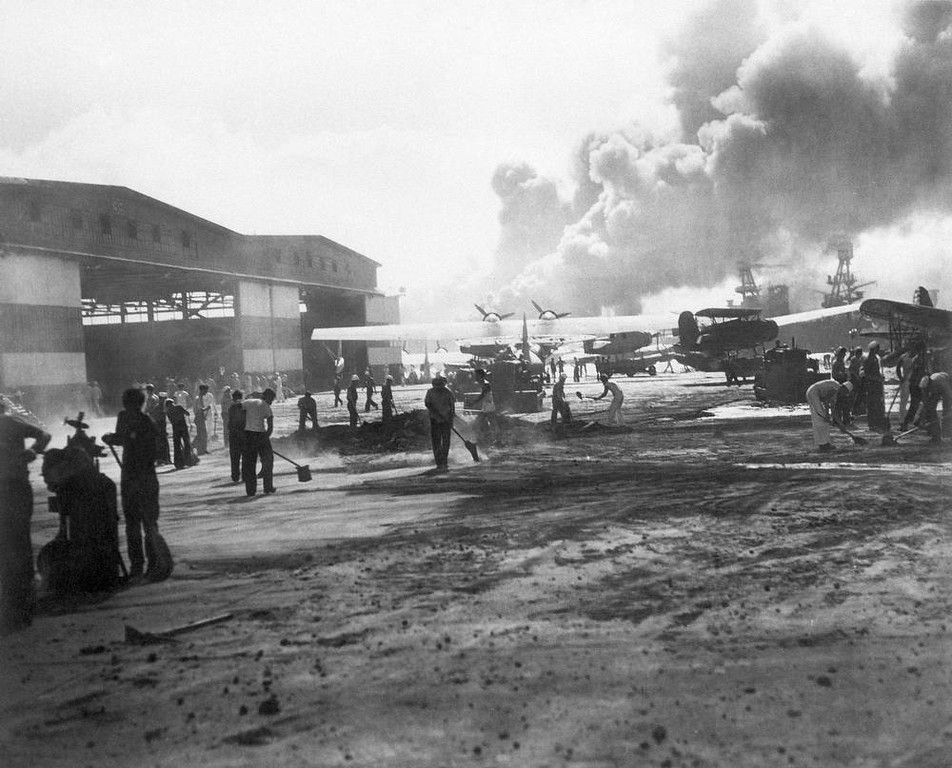 . In this photo provided by the U.S. Navy, hanger No. 6 and the warm-up apron of the air station landing strip on Ford Island in Pearl Harbor, Hawaii shown during the attack, Dec. 7, 1941. (AP Photo/U.S. Navy)