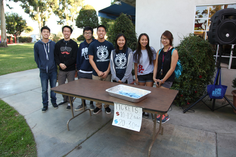 Interact students from Bolsa Grande High School helped sell 50/50 tickets, serve food and distribute prizes.  Camera has an unfortunate tendency to focus on the closest object, in this case the sign....