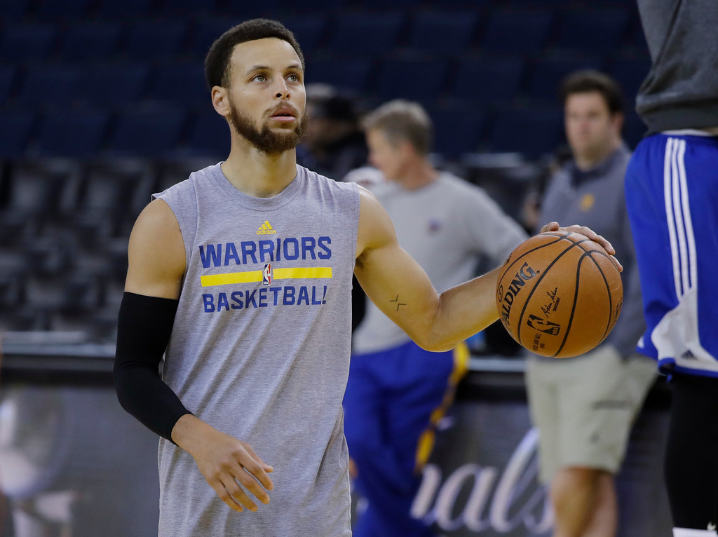 . Golden State Warriors\' Stephen Curry dribbles during an NBA basketball practice, Wednesday, May 31, 2017, in Oakland, Calif. The Golden State Warriors face the Cleveland Cavaliers in Game 1 of the NBA Finals on Thursday in Oakland. (AP Photo/Marcio Jose Sanchez)