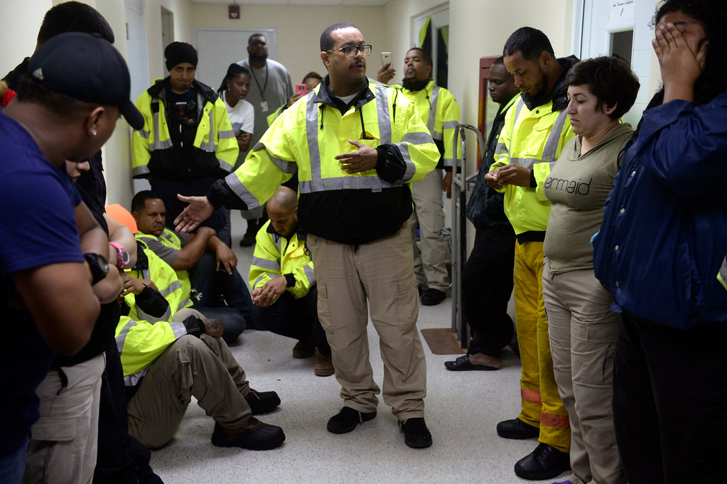 . CORRECTS DAY OF WEEK TO WEDNESDAY FROM TUESDAY - Team leader Joey Rivera gives a speech while the team waits to assist in the aftermath of Hurricane Maria in Humacao, Puerto Rico, Wednesday, Sept. 20, 2017. (AP Photo/Carlos Giusti)