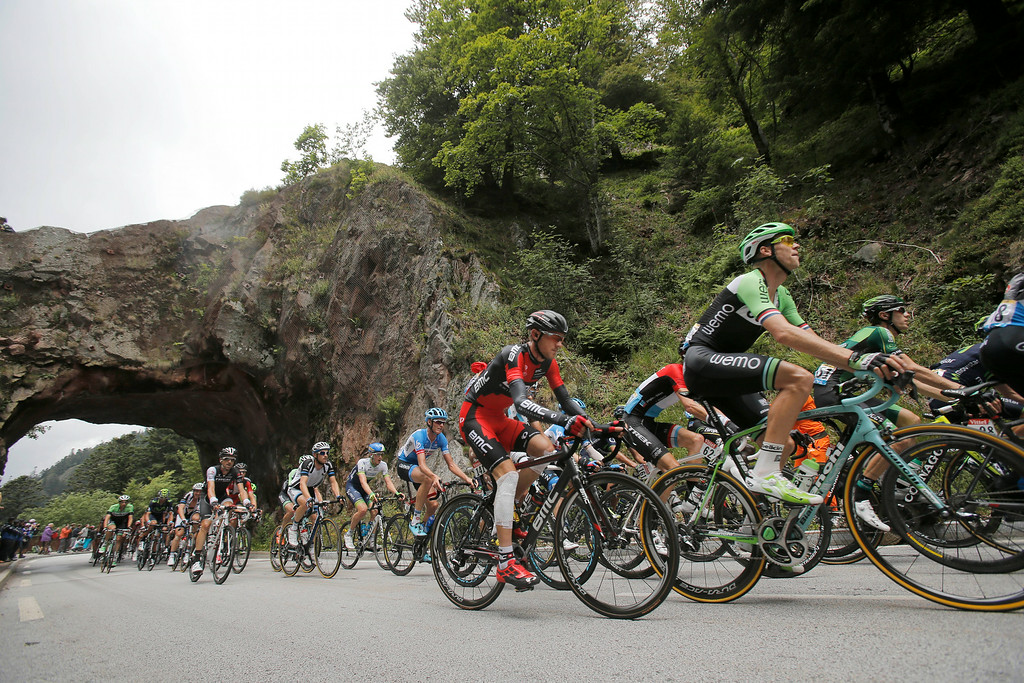 . Tejay van Garderen of the U.S., center with bandaged knee, and Netherland\'s Lars Boom, right, ride in the pack during the ninth stage of the Tour de France cycling race over 170 kilometers (105.6 miles) with start in Gerardmer and finish in Mulhouse, France, Sunday, July 13, 2014. (AP Photo/Christophe Ena)