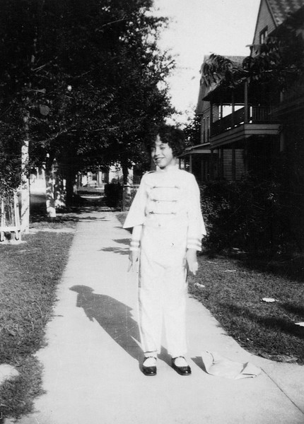 1930ish Annie Kennedy in school band uniform on Providence Street in Houston.JPG