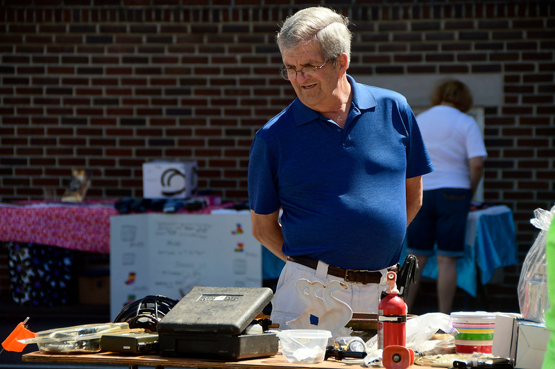 7/21/2018 Mike Orazzi | Staff Paul Bouffard during the West End Flea Market held at the Immanuel Lutheran Church on West Street in Bristol Saturday morning.