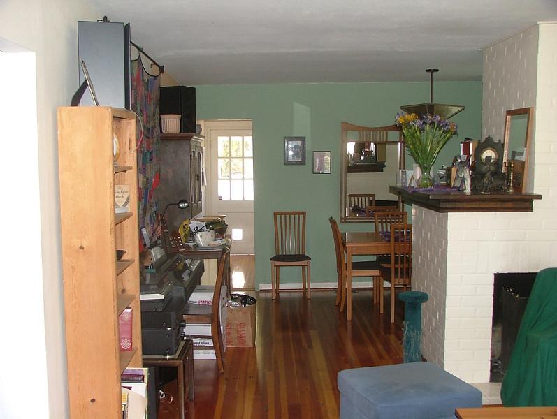 view from in LR looking through dining room past kitchen to back door (with cat door)