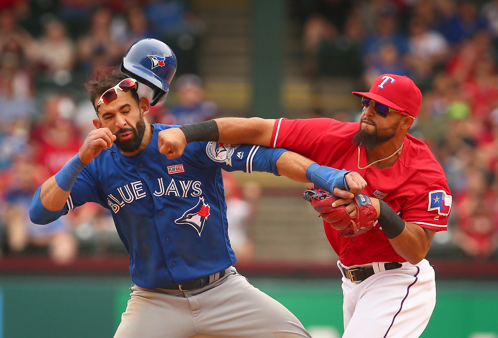 . Toronto Blue Jays Jose Bautista (19) gets hit by Texas Rangers second baseman Rougned Odor (12) after Bautista slid into second in the eighth inning of a baseball game at Globe Life Park in Arlington, Texas, Sunday May 15, 2016. (Richard W. Rodriguez/Star-Telegram via AP)