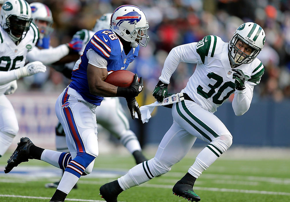 . New York Jets free safety LaRon Landry (30) moves in for a tackle on Buffalo Bills running back C.J. Spiller (28) during the first half an NFL football game on Sunday, Dec. 30, 2012, in Orchard Park, N.Y. (AP Photo/Mel Evans)