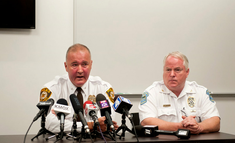 . St. Louis County Police Chief Jon Belmar, left, delivers remarks as Ferguson Police Chief Thomas Jackson listens during a news conference, Sunday, Aug. 10, 2014 in Ferguson, Mo., where the men addressed issues surrounding the shooting of Michael Brown, 18, by Ferguson police Saturday, Aug. 9, 2014. Brown died following the confrontation with police, according to Belmar. (AP Photo/Sid Hastings)