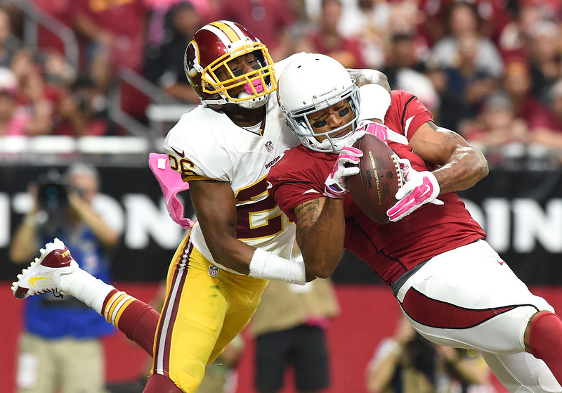 . Wide receiver Michael Floyd #15 of the Arizona Cardinals hauls in a first-quarter touchdown pass against corner back Bashaud Breeland #26 of the Washington Redskins during the NFL game at University of Phoenix Stadium on October 12, 2014 in Glendale, Arizona.  (Photo by Norm Hall/Getty Images)