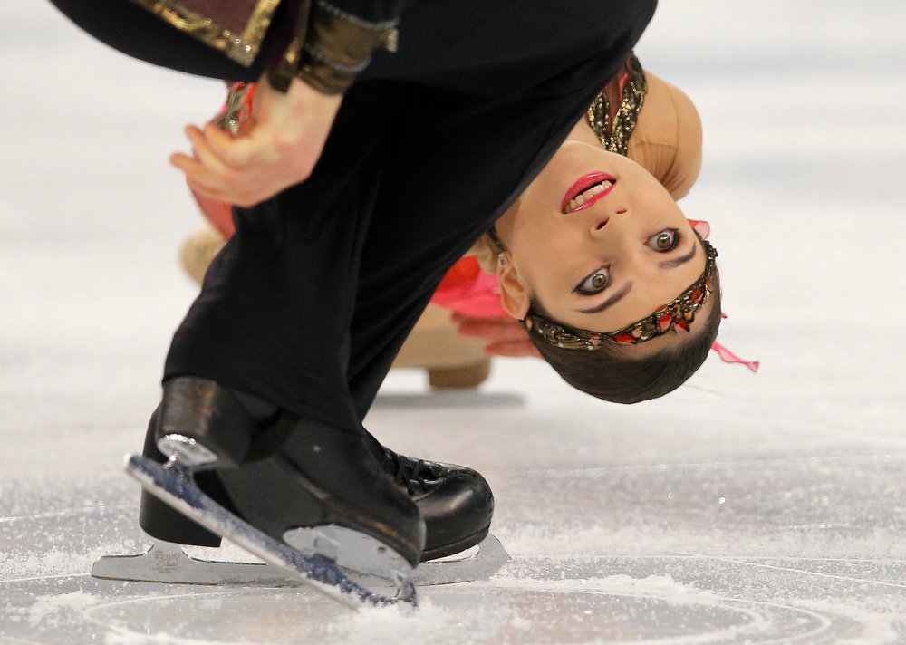 . Vera Bazarova and Yuri Larionov of Russia compete in the pairs free skate figure skating competition at the Iceberg Skating Palace during the 2014 Winter Olympics, Wednesday, Feb. 12, 2014, in Sochi, Russia. (AP Photo/Vadim Ghirda)