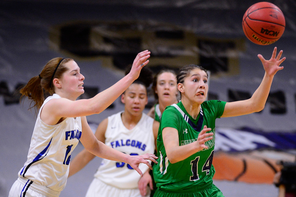 . Alyssia Martinez (14) of ThunderRidge goes after a loose ball while Courtney Humbarger (12) of Highlands Ranch tries to beat her to it during the second quarter at the Coors Events Center on March 12, 2016 in Boulder, Colorado. (Photo by Brent Lewis/The Denver Post)
