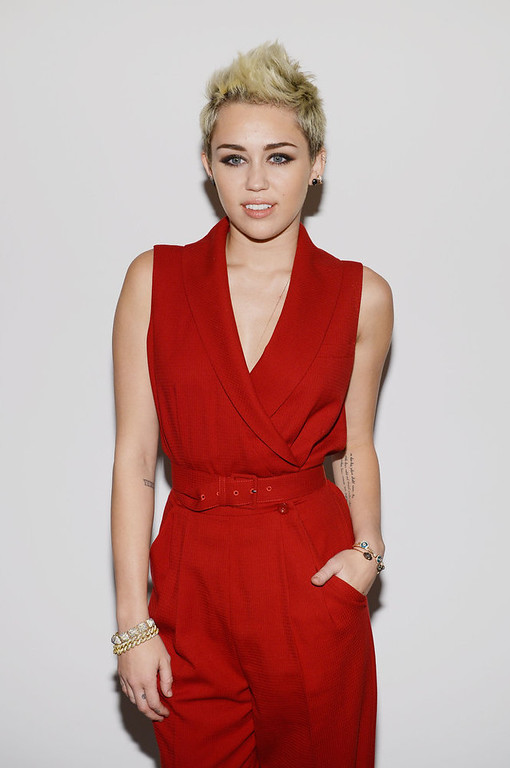 . Miley Cyrus attends the Rachel Zoe Fall 2013 fashion show during Mercedes-Benz Fashion Week at The Studio at Lincoln Center on February 13, 2013 in New York City.  (Photo by Larry Busacca/Getty Images for Mercedes-Benz Fashion Week)