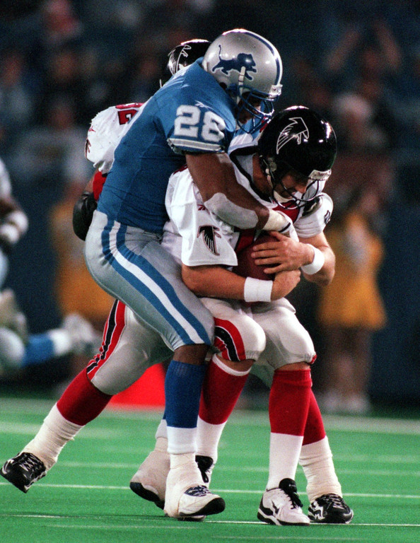 . The Detroit Lions safety Ron Rice sacks the Atlanta Falcons quarterback Chris Chandler for a loss in the fourth quarter.  Chadler 11 0f 19 for 146 yards. The Falcons beat the Lions 24-17 at the Pontiac Silverdome.