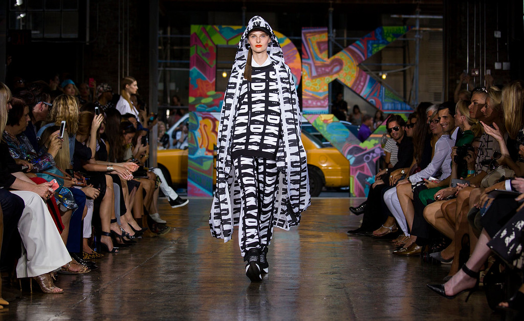 . The DKNY Spring 2014 collection is modeled during Fashion Week in New York, Sunday, Sept. 8, 2013. (AP Photo/Craig Ruttle)