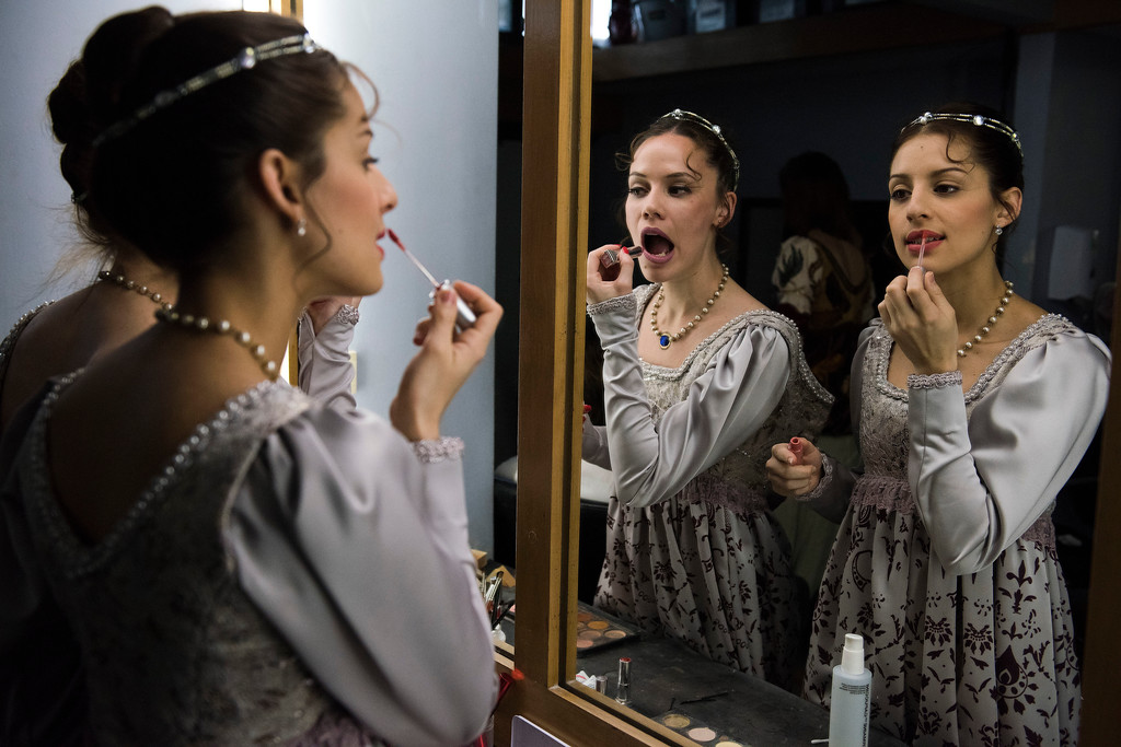 . In this Friday, Sept. 15, 2017 photo, ballet dancers from Uruguay�s National ballet of the Sodre put on lipstick before a dress rehearsal for Romeo and Juliet in Montevideo, Uruguay. Dancers practice Monday through Friday for eight hours at a time. (AP Photo/Matilde Campodonico)