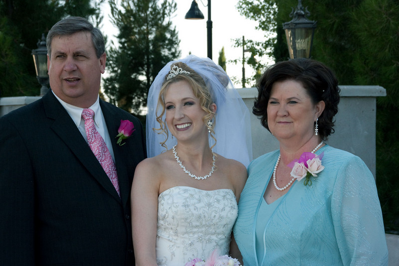 Bride with stepfather and mother