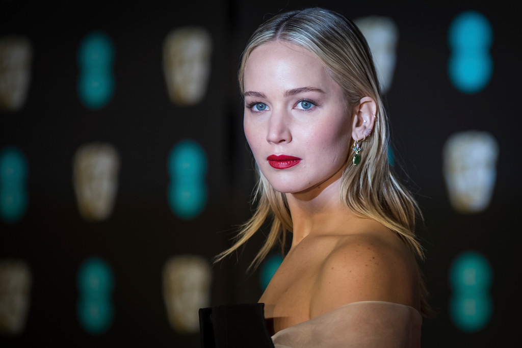 . Jennifer Lawrence poses for photographers upon arrival at the BAFTA Film Awards, in London, Sunday, Feb. 18, 2018. (Photo by Vianney Le Caer/Invision/AP)