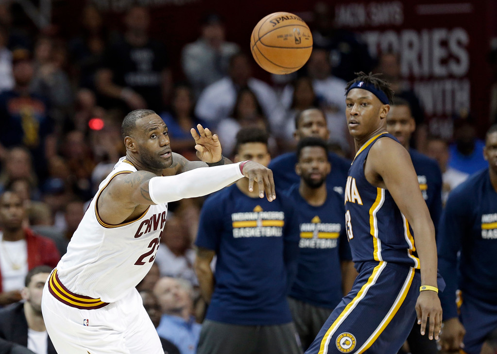 . Cleveland Cavaliers\' LeBron James, left, passes against Indiana Pacers\' Myles Turner in the second half in Game 1 of a first-round NBA basketball playoff series, Saturday, April 15, 2017, in Cleveland. (AP Photo/Tony Dejak)