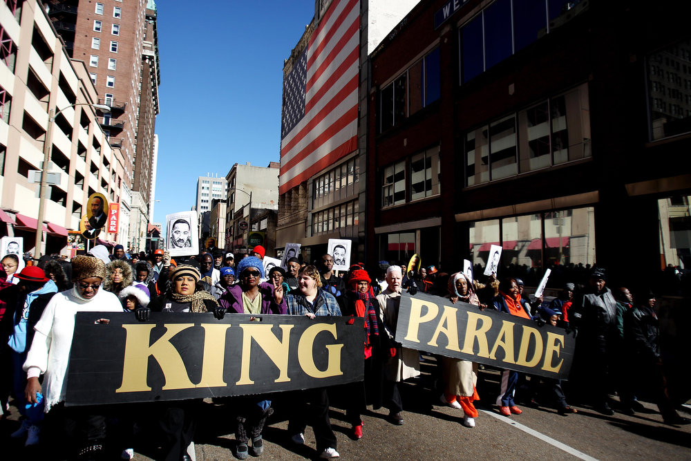 . Participants in the 28th annual Martin Luther King Jr. Holiday Parade walk down 2nd Street in Memphis, Tenn. Monday, Jan. 21, 2013. Hundreds marched from the Pinch District to the National Civil Rights Museum to commemorate the birthday of civil rights leader Martin Luther King Jr. (AP Photo/The Commercial Appeal, Mike Brown)