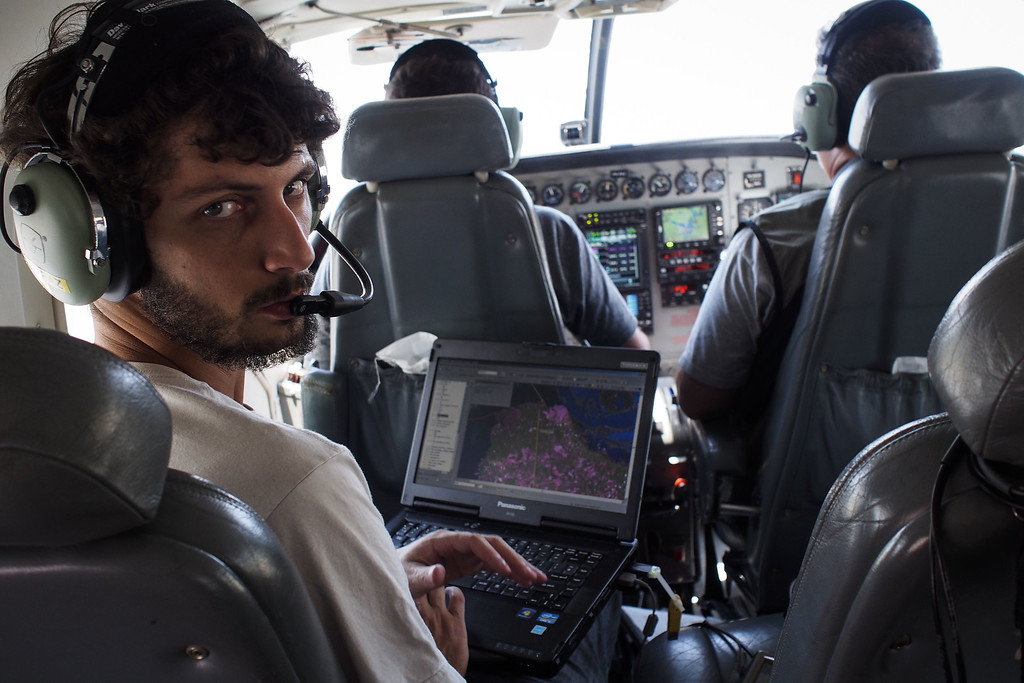 """. Greenpeace navigator Andre Arruda shows in a laptop the route the NGO\'s airplane is taking to fly over areas of illegal exploitation of timber, as part of the second stage of the \""""The Amazon\'s Silent Crisis\"""" report in Santarem, state of Para, Brazil, on October 14, 2014. RAPHAEL ALVES/AFP/Getty Images"""