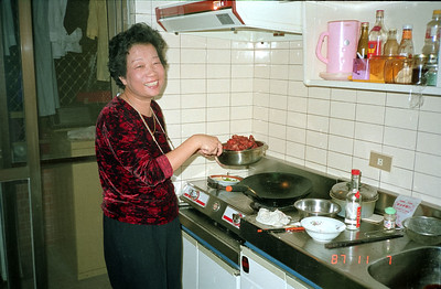 Henry Fan's mom in her kitchen preparing a great number of Chinese dishes for tonight's dinner!