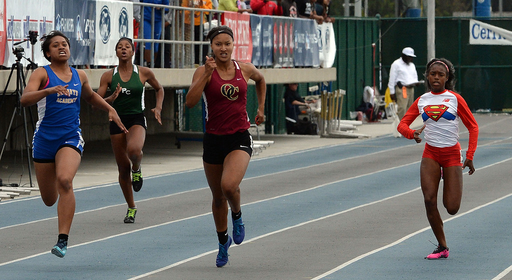 . Oaks Christian\'s Schuyler Moore, center, wins the division 4 200 meters race during the CIF Southern Section track and final Championships at Cerritos College in Norwalk, Calif., Saturday, May 24, 2014.   (Keith Birmingham/Pasadena Star-News)